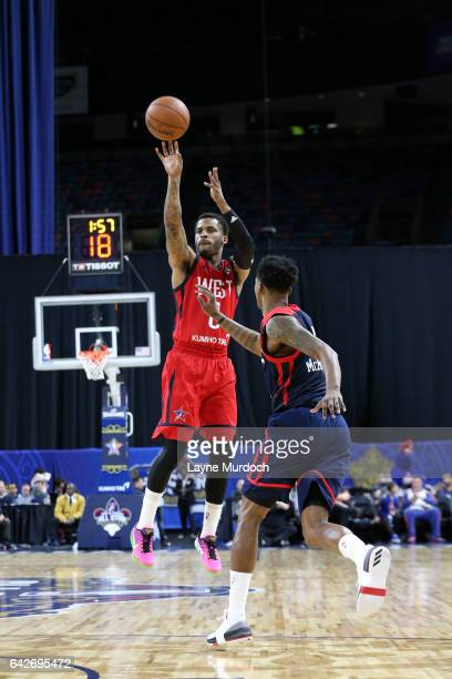 Vander Blue of the West Team shoots against Alfonzo McKinnie of the East Team during the NBA DLeague AllStar Game presented by Kumho Tires as part of...