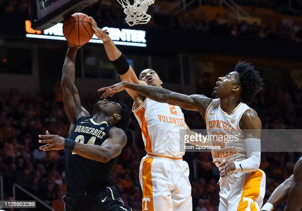 Vanderbilt Commodores forward Aaron Nesmith takes a shot while being defended by Tennessee Volunteers forward Grant Williams and guard Jordan Bowden...