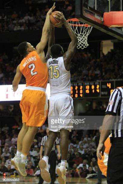 Vanderbilt Commodores forward Clevon Brown has his dunk attempt blocked by Tennessee Volunteers forward Grant Williams in a regular season game...