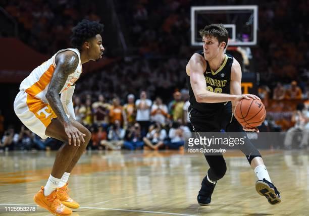 Vanderbilt Commodores forward Matt Ryan passes the ball around Tennessee Volunteers guard Jordan Bowden during a college basketball game between the...