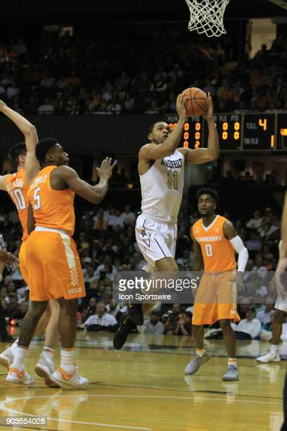 Vanderbilt Commodores guard Jeff Roberson drives past Tennessee Volunteers Admiral Schofield and Jordan Bone for a layup in a regular season game...