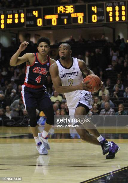 Vanderbilt Commodores guard Joe Toye drives past Ole Miss Rebels Breein Tyree for a layup in the first half of a game between the Vanderbilt...