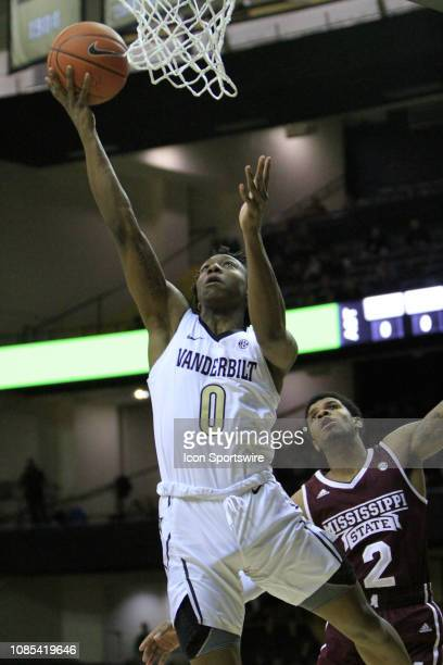 Vanderbilt Commodores guard Saben Lee drives for a layup past Mississippi State guard Lamar Peters in a game between the Vanderbilt Commodores and No...