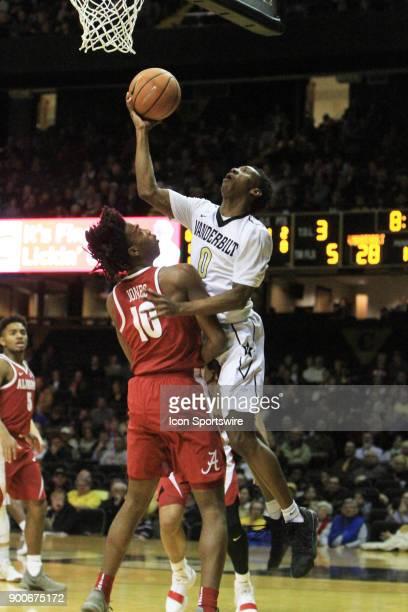 Vanderbilt Commodores guard Saben Lee scores a layup over Alabama Crimson Tide defender Herbert Jones during a Southeastern Conference game between...
