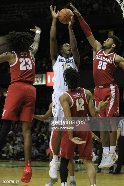 Vanderbilt Commodores guard Saben Lee shoots over a trio of Alabama Crimson Tide defenders during a Southeastern Conference game between the...