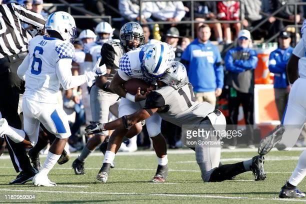 Vanderbilt Commodores safety Max Worship tackles Kentucky Wildcats quarterback Lynn Bowden Jr during a game between the Vanderbilt Commodores and...