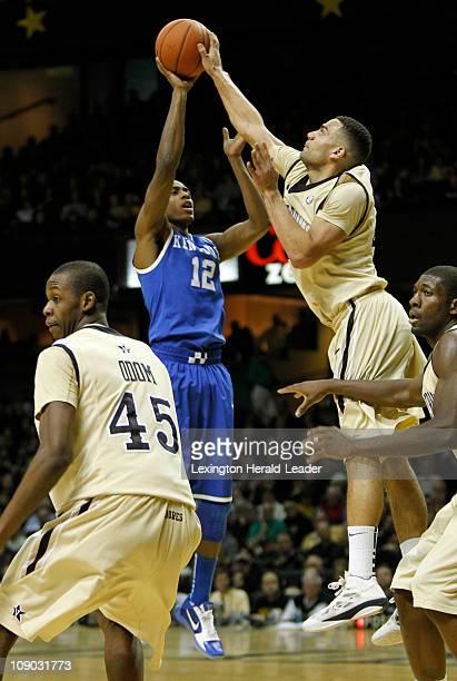 Vanderbilt forward Jeffery Taylor blocks a shot of Kentucky guard Brandon Knight during game action at Memorial Gym in Nashville Tennessee Saturday...