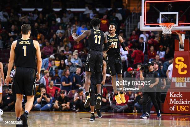 Vanderbilt forward Simisola Shittu and Vanderbilt guard Darius Garland celebrate after winning a college basketball game between the Vanderbilt...