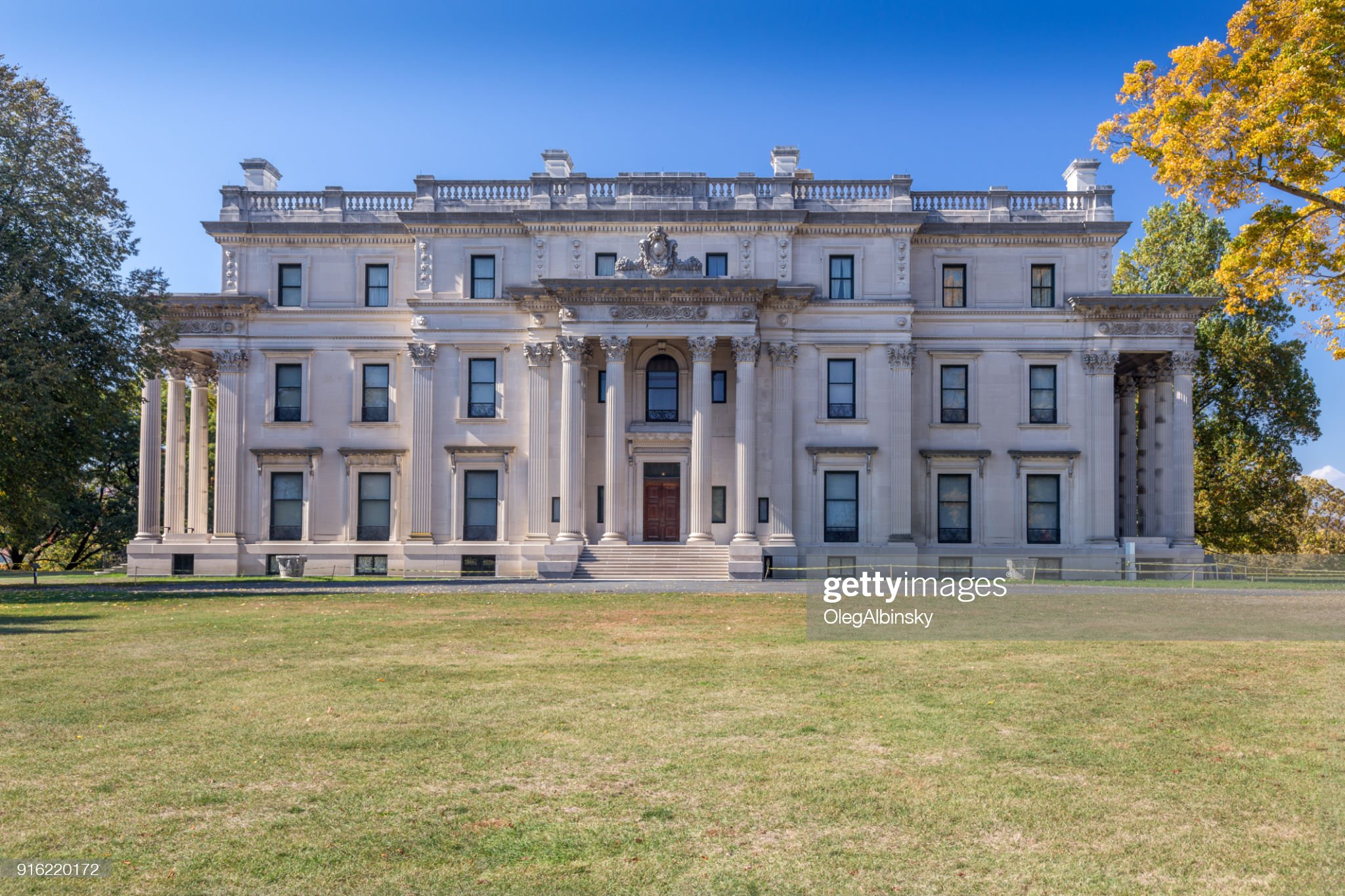 Vanderbilt Mansion National Historic Site with Trees in Fall Colors (Foliage) and Vivid Blue Sky, Hyde Park, New York. : Stock Photo
