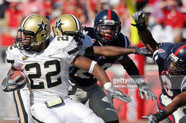 Vanderbilt running back Cassen Jackson-Garrison changes direction against the Ole Miss defense at Vaught-Hemingway Stadium in Oxford, Mississippi,...