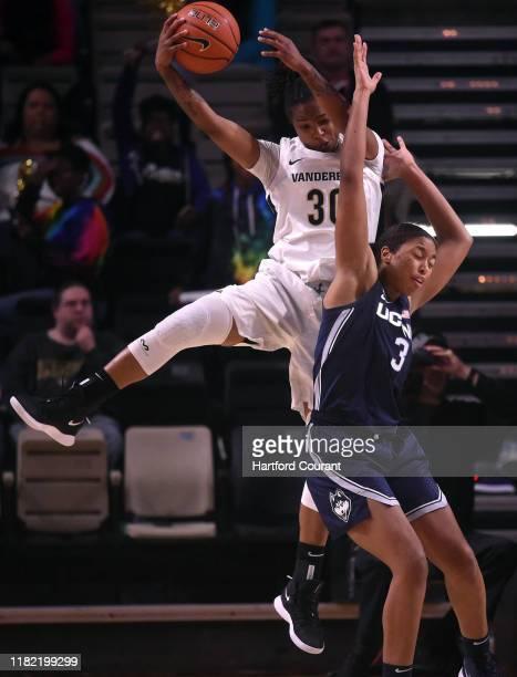 Vanderbilt's Lea Lea Carter grabs a rebound over Connecticut's Megan Walker at Vanderbilt Memorial Gymnasium Nashville Tenn on Wednesday Nov 13 2019...