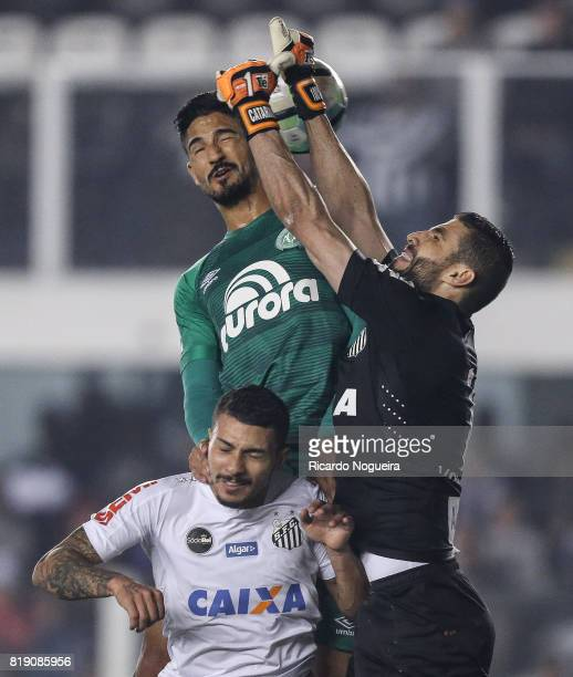 Vanderlei and Alison 5# of Santos battle for the ball with Lourency of Chapecoense during the match between Santos and Chapecoense as a part of...