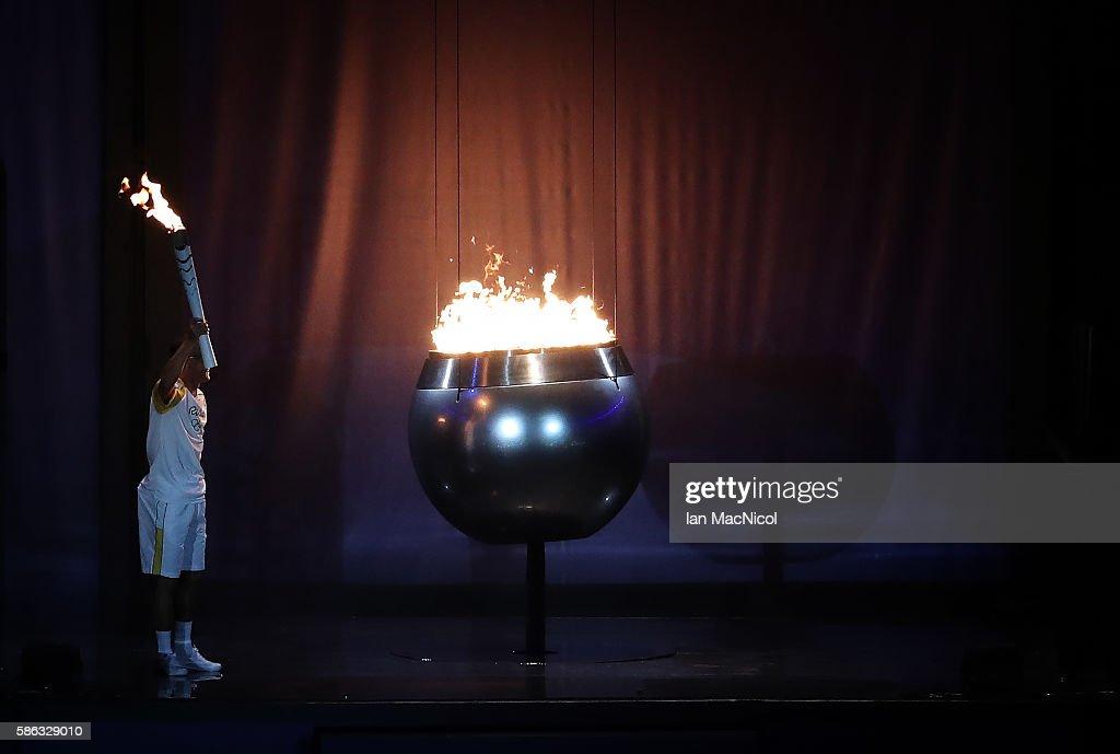 Vanderlei de Lima lights the Olympic Cauldron during The 2016 Summer Olympics Opening Ceremony at Maracana Stadium on August 5, 2016 in Rio de Janeiro, Brazil.