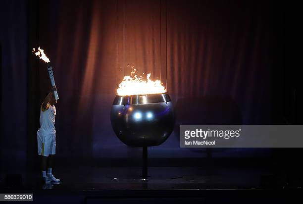 Vanderlei de Lima lights the Olympic Cauldron during The 2016 Summer Olympics Opening Ceremony at Maracana Stadium on August 5, 2016 in Rio de...
