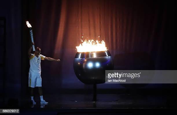 Vanderlei de Lima lights the Olympic Cauldron during The 2016 Summer Olympics Opening Ceremony at Maracana Stadium on August 5 2016 in Rio de Janeiro...
