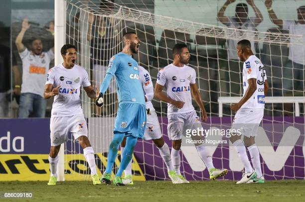 Vanderlei goalkeeper of Santos celebrates with your teammates after defending a penalty kick by Alecssandro of Coritiba during a match between Santos...