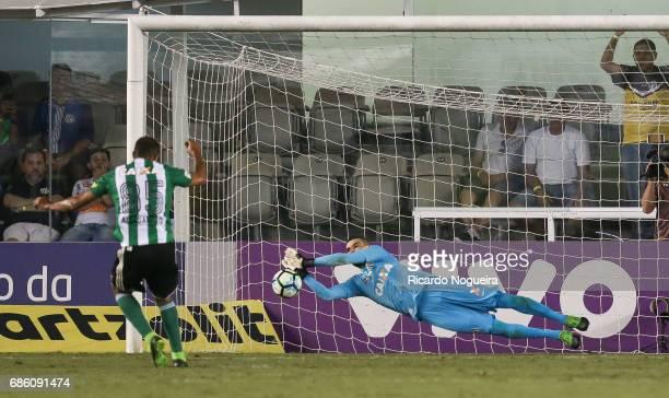 Vanderlei goalkeeper of Santos defends a penalty kick by Alecssandro of Coritiba during a match between Santos and Coritiba as a part of Campeonato...