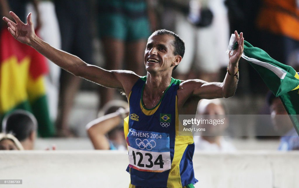 Vanderlei Lima of Brazil celebrates after finishing third and winning the bronze medal in the men's marathon on August 29, 2004 during the Athens 2004 Summer Olympic Games at Panathinaiko Stadium in Athens, Greece.