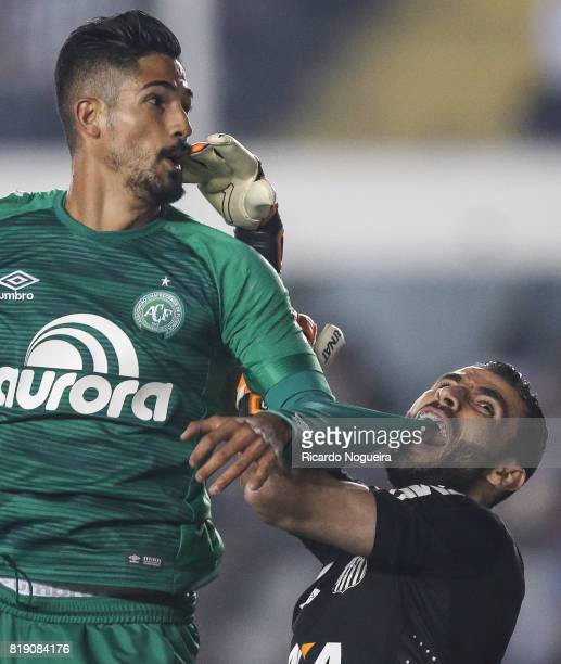 Vanderlei of Santos stays with the shirt of Tulio de Melo of Chapecoense stuck in his teeth during the match between Santos and Chapecoense as a part...