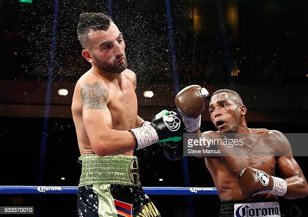 Vanes Martirosyan takes a punch from WBA super welterweight champion Erislandy Lara during their title fight at The Chelsea at The Cosmopolitan of...