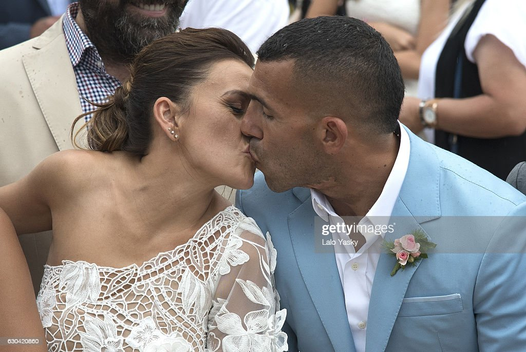 Vanesa Mansilla and Carlos Tevez leave the San Isidro City Hall after their civil wedding ceremony on December 22, 2016 in Buenos Aires, Argentina.