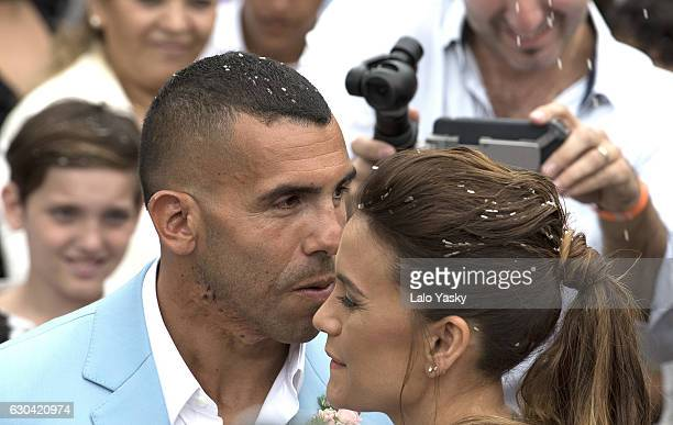 Vanesa Mansilla and Carlos Tevez leave the San Isidro City Hall after their civil wedding ceremony on December 22 2016 in Buenos Aires Argentina