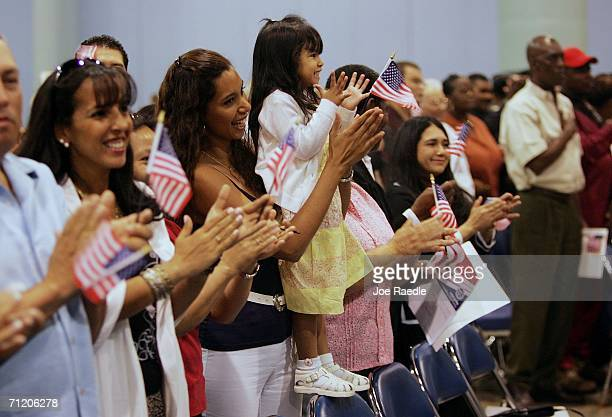 Vanessa Arevalo and her daughter Nicole Arevalo clap after being sworn in with 3000 others at the Miami Beach Convention Center June 14 2006 in Miami...