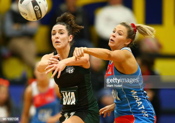 Vanessa Augustini of the Magpies and Sophie Halpin of the Waratahs contest possession during the Australian Netball League semi final between the NSW...