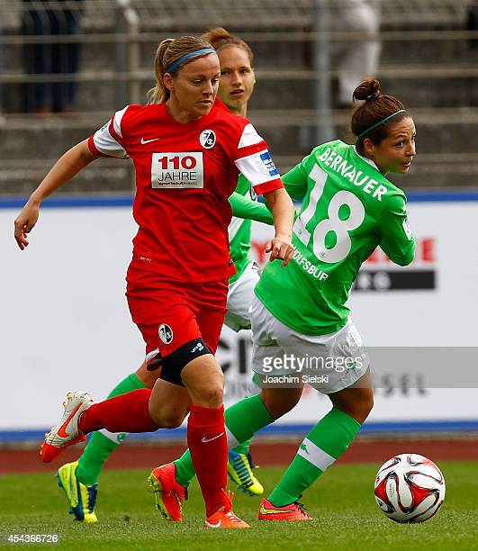 Vanessa Bernauer of Wolfsburg challenges Juliane Maier of Freiburg during the Allianz Women's Bundesliga match between VfL Wolfsburg and SC Freiburg...