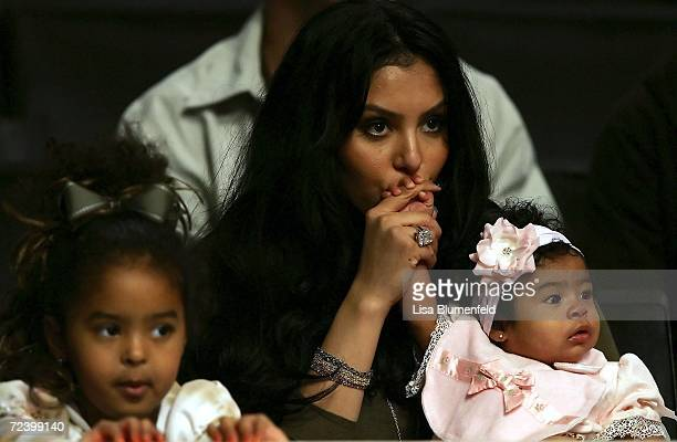 Vanessa Bryant the wife of Kobe Bryant of the Los Angeles Lakers sits with their two girls Natalia Diamante and Gianna MariaOnore before the game...
