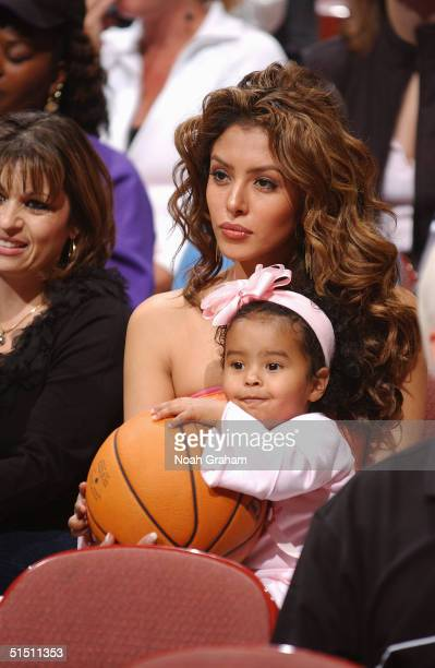 Vanessa Bryant wife of Kobe Bryant of the Los Angeles Lakers holds their child Natalia Diamante Bryant during the preseason game against the Seattle...