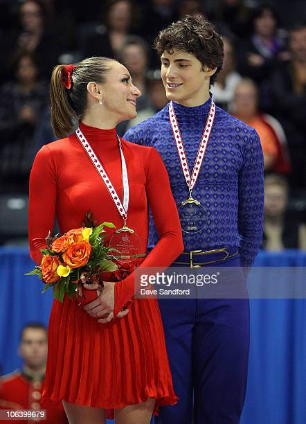 Vanessa Crone and Paul Poirier of Canada receive their gold medals after skating to a 1st place finish in Ice Dance Free Dance during 2010 Skate...
