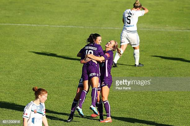 Vanessa DiBernardo Rosie Sutton and Nicole Stanton of the Glory celebrate a goal during the round 11 WLeague match between the Perth Glory and...