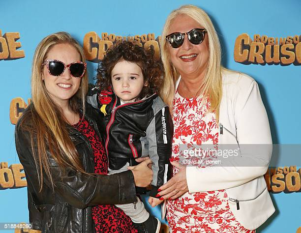 Vanessa Feltz with daughter Allegra Kurer and her son Zeke attend a VIP screening of Robinson Crusoe at the Vue West End on April 3 2016 in London...