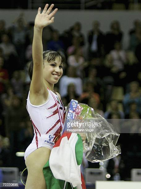 Vanessa Ferrari of Italy celebrates her gold medal on the podium after the womens allarounds finals during the World Artistic Gymnastics...