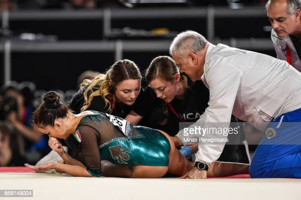 Vanessa Ferrari of Italy receives medical attention while competing on the floor exercise during the individual apparatus finals of the Artistic...