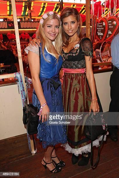 Vanessa Fischer und sister Cathy Hummels attend the Regines Sixt Damen Wiesn during the Oktoberfest 2015 on September 21 2015 in Munich Germany