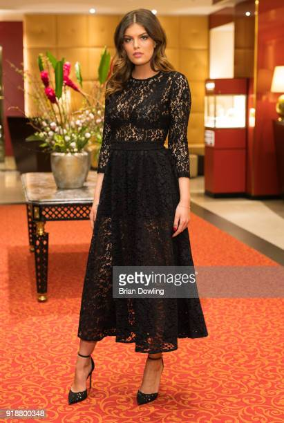 Vanessa Fuchs pose for a photo while wearing a gown by Matsour'i at the Steigenberger Hotel on