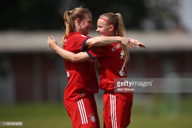 Vanessa Fudalla of Muenchen celebrates her team's second goal with team mate Claudia van den Heiligenberg during the 2 Frauen Bundesliga match...
