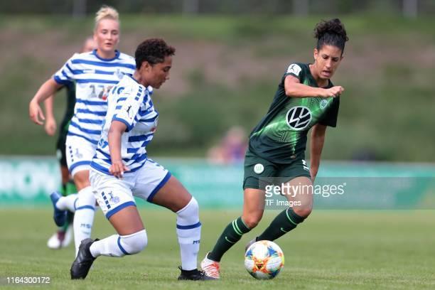 Vanessa Fuerst of MSV Duisburg and Claudia Neto of VfL Wolfsburg battle for the ball during the FLYERALARM Frauen Bundesliga match between MSV...