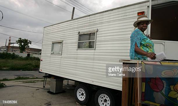 Vanessa Gaten stands on the front steps of her FEMA trailer with the Superdome in the background June 7 2007 in New Orleans Louisiana Gaten says she...