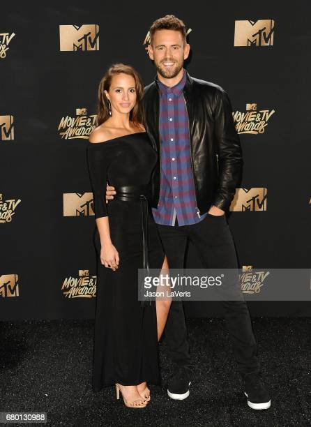 Vanessa Grimaldi and Nick Viall pose in the press room at the 2017 MTV Movie and TV Awards at The Shrine Auditorium on May 7 2017 in Los Angeles...