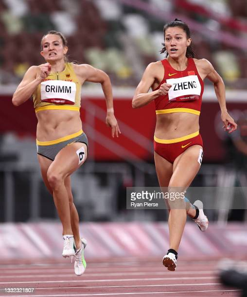 Vanessa Grimm of Team Germany and Ninali Zheng of Team China compete in the Women's Heptathlon 200m heats on day twelve of the Tokyo 2020 Olympic...