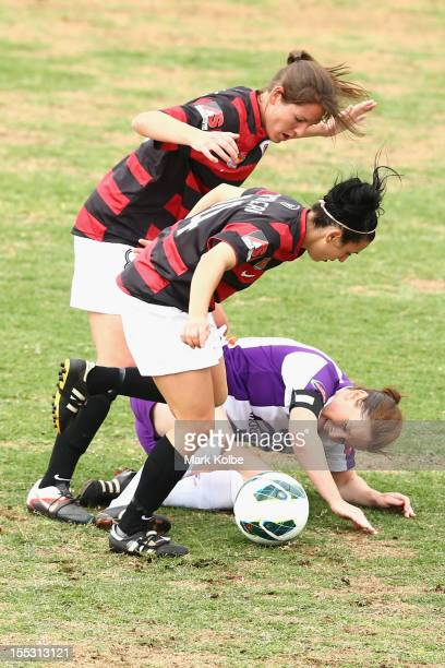 Vanessa Hart and Trudy Camilleri of the Wanderers tackle Collette MCCallum of the Glory during the round three W-League match betweeh the Western...