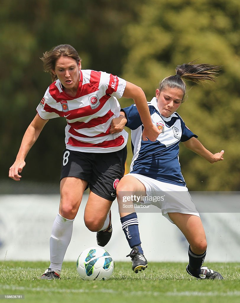 Vanessa Hart of the Wanderers and Enza Barilla of the Victory compete for the ball during the round 10 W-League match between the Melbourne Victory and the Western Sydney Wanderers at Wembley Park on December 22, 2012 in Melbourne, Australia.