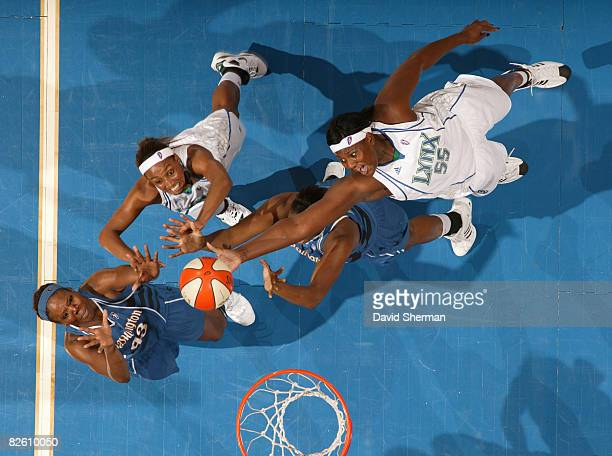 Vanessa HaydenJohnson and Candice Wiggins of the Minnesota Lynx go for the rebound against Nakia Sanford and Andrea Gardner of the Washington Mystics...