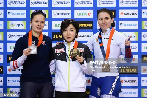 Vanessa Herzog of Austria Nao Kodaira of Japan and Angelina Golikova of Russia stand on the podium after the women's 500m duing the ISU World Cup...