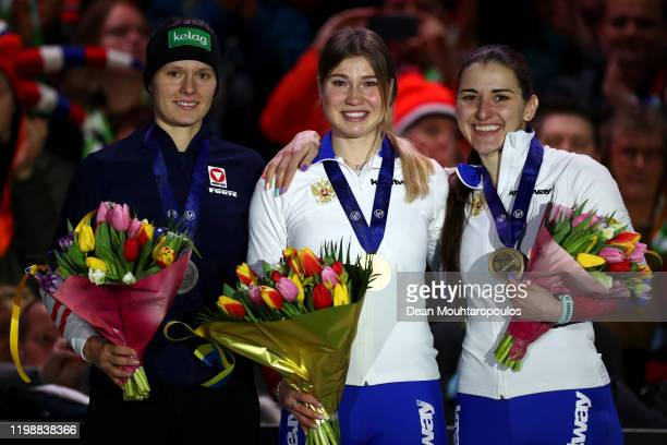 Vanessa Herzog of Austria with the silver medal Olga Fatkulina of Russia celebrates winning the gold medal and Angelina Golikova of Russia the bronze...