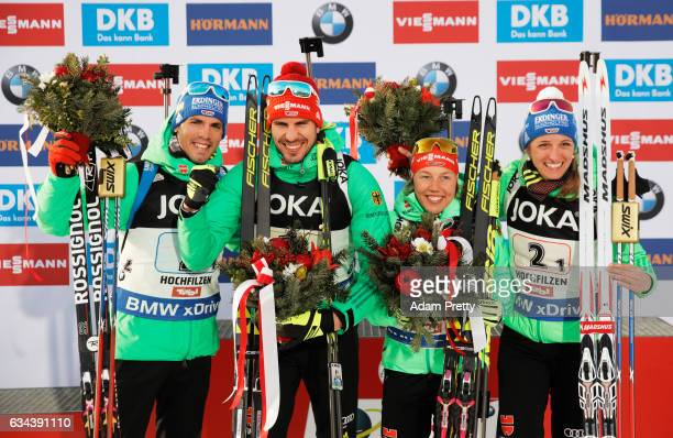 Vanessa Hinz Laura Dahlmeier Arnd Pfeiffer and Simon Schempp of Germany celebrate winning gold after the Mixed Relay competition of the IBU World...