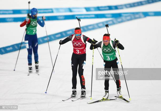 Vanessa Hinz of Germany completes the first leg as teammate Laura Dahlmeier of Germany begins the second during the Biathlon 2x6km Women 2x75km Men...